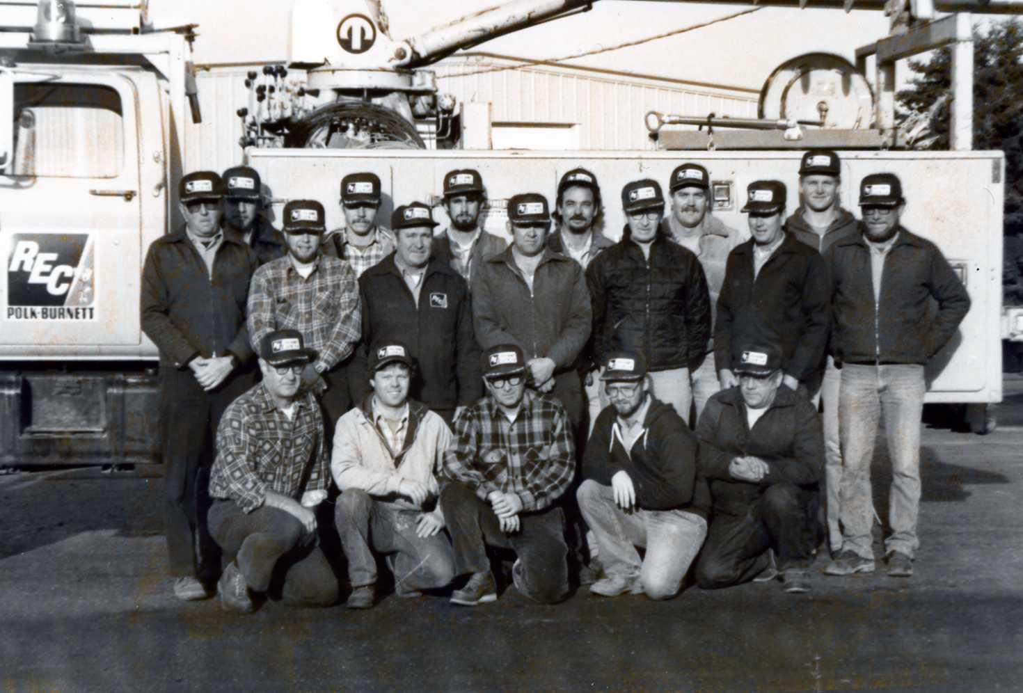 https://polkburnett.com/sites/default/files/revslider/image/Group_Photo_Linemen_by_Truck_Mid_80s.jpg